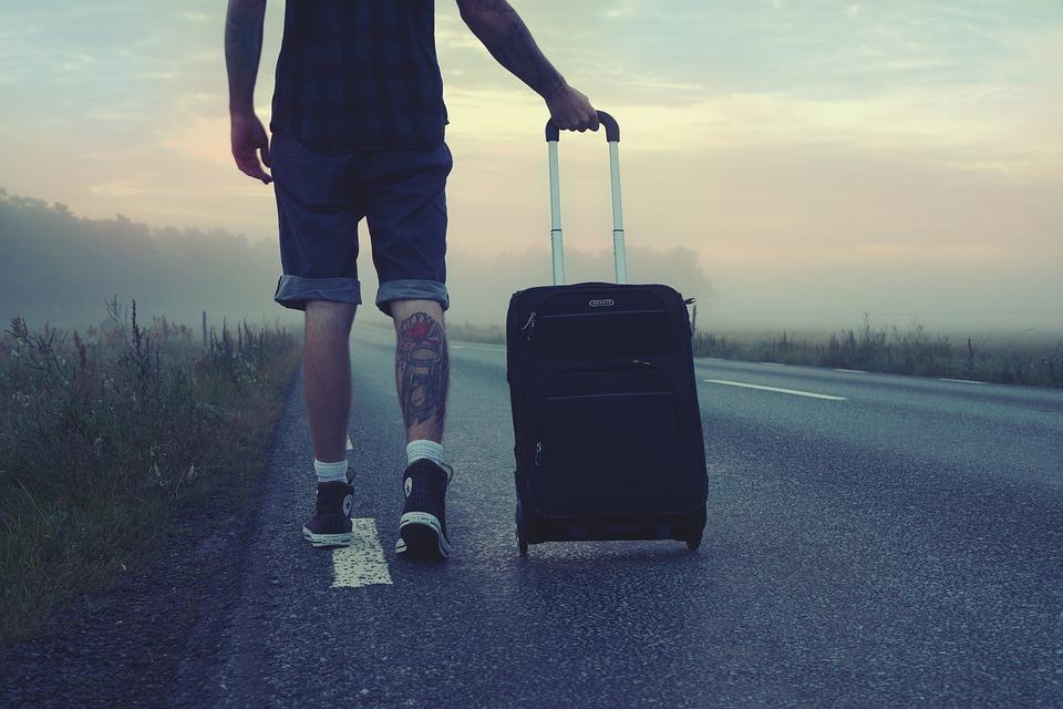 Man walking with stroller bag